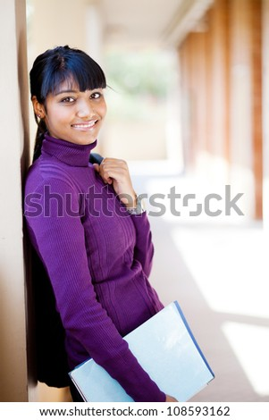 attractive female asian college student on campus - stock photo
