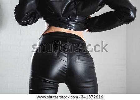 Attractive female ass in leather trousers