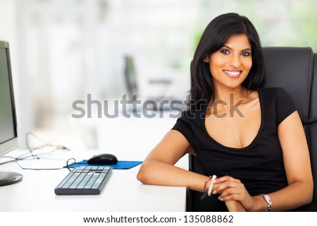 attractive female business executive in modern office - stock photo