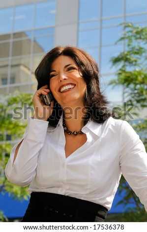 Attractive Female Business Executive Making A Phone Call Outside - stock photo