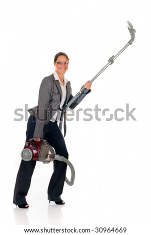 Attractive female businesswoman with vacuum cleaner.  studio shot.