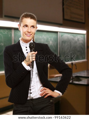 attractive female conference speaker during presentation