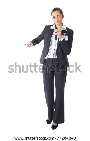attractive female conference speaker during presentation, holds microphone and makes some gestures, full body shoot, isolated on white