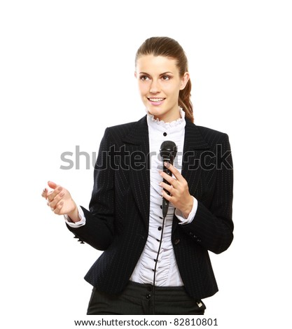 attractive female conference speaker during presentation, holds microphone full body shoot, isolated on white - stock photo