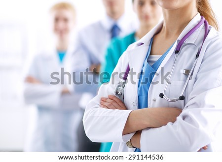 Attractive female doctor in front of medical group . - stock photo