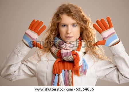 Attractive female dressed up warm in scarf, gloves and coat.? - stock photo