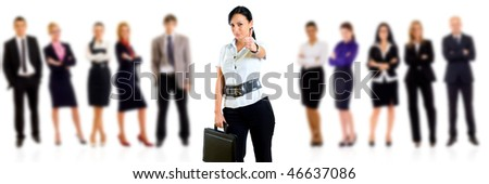 Attractive female executive smiling at the camera with thumb up. Success concept.