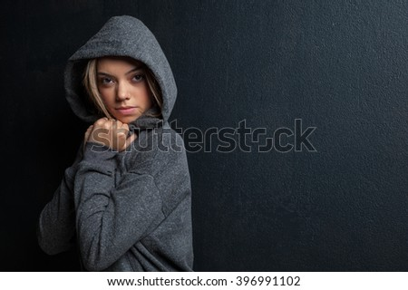Attractive female fitness model isolated on a black background in sports wear - stock photo