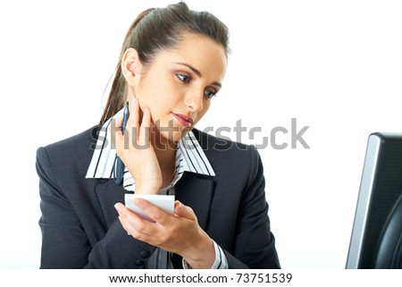 attractive female in suit and shirt make notes, copy something from monitor in front of her, isolated on white