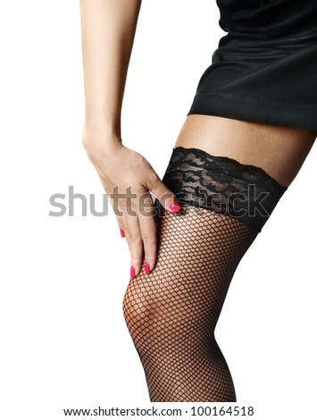 Attractive female legs in black stockings