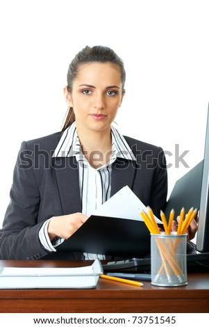 attractive female office worker checks something in her documents, folder, isolated on white