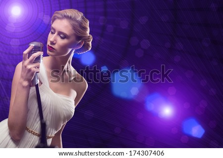attractive female singer with a microphone behind her abstract background