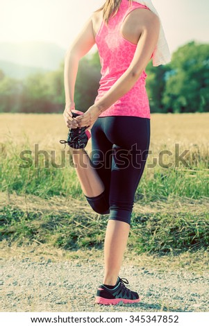 Attractive female stretching before jogging