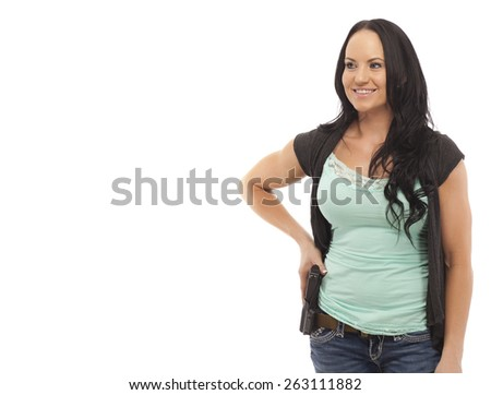 Attractive female with handgun against white background - stock photo