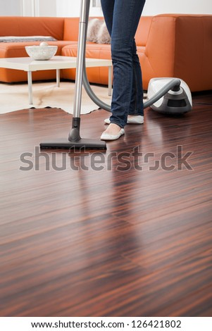 Attractive Female with Vacuum Cleaner - stock photo