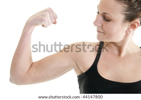 Attractive, fit Caucasian woman flexes her muscle - stock photo