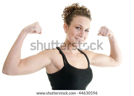 Attractive, fit Caucasian woman flexes her muscles
