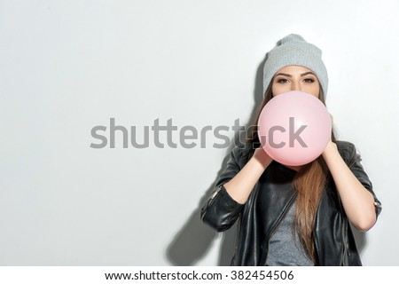 Attractive fit girl is blowing up the gift - stock photo
