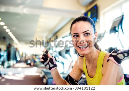 Attractive fit woman in a gym taking a break - stock photo