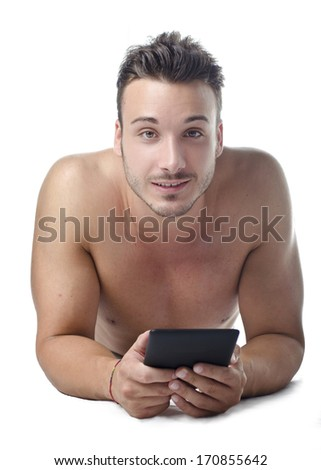 Attractive, fit young man holding ebook reader or tablet, smiling to camera