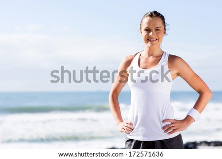 attractive fitness woman posing outside on beach