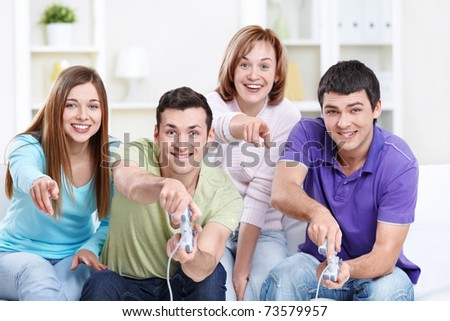 Attractive friends play video games - stock photo