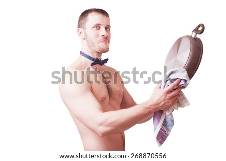 Attractive funny man with a towel wipes clean pan, isolated - stock photo
