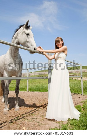 attractive girl and horse. outdoor shot