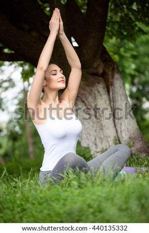 Attractive girl calming down in the nature