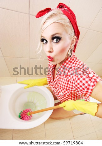 Attractive girl cleaning toilet, similar available in my portfolio - stock photo