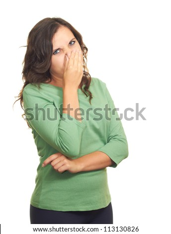 Attractive girl in a green shirt from the stench covers her nose. Isolated on white background - stock photo