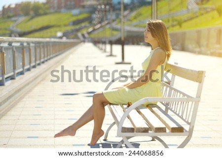 Attractive girl in a yellow dress. urban style
