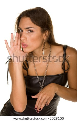 attractive girl in leather dress whispering - stock photo