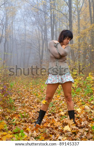 attractive girl in the autumn forest - stock photo