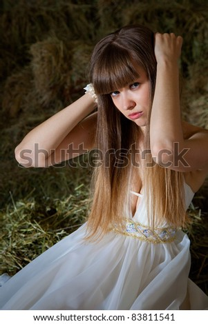 attractive girl in the hay. rural portrait
