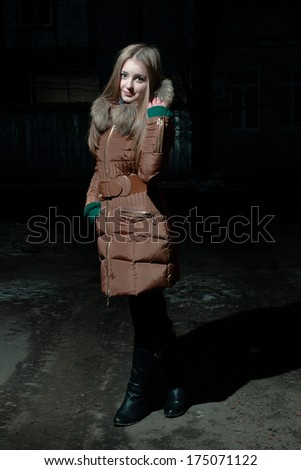 Attractive girl in winter looking at the camera and smiling