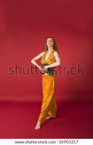 attractive girl in yellow dress in meditation - stock photo