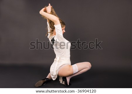 attractive girl is a white clothes and stocking in studio - stock photo