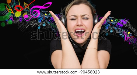 attractive girl listens to music expressively