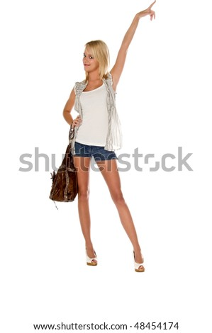 Attractive girl next door  fashion model in jean shorts, tank top and layered blouse  leather purse and a sassy expression