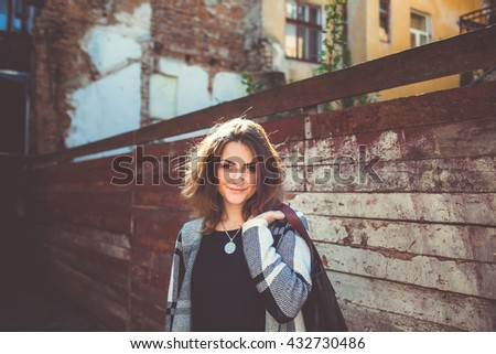 Attractive girl on a background of a wooden backgrounds - stock photo