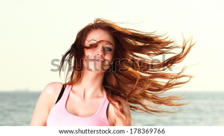 Attractive girl on pier winter in hair Young woman on background of sea sky - stock photo