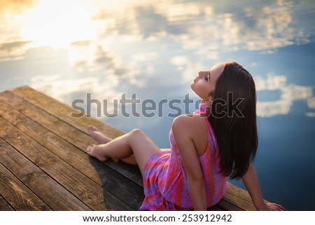 Attractive girl on the pier - stock photo