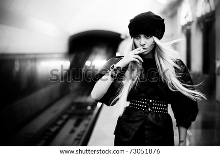 Attractive girl on the subway - stock photo