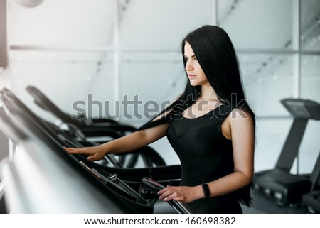 attractive girl on the treadmill