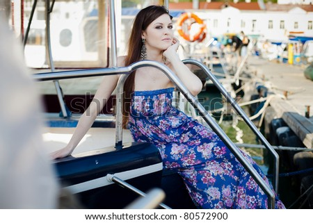 attractive girl on yacht - stock photo