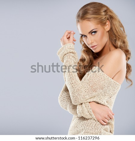 Attractive girl posing while isolated against a grey background - stock photo