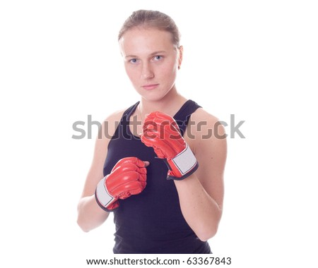 Attractive girl practicing boxing isolated on white background