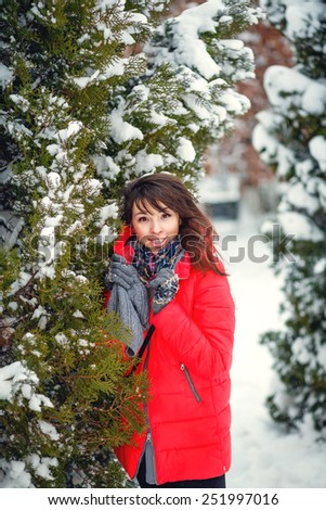 Attractive girl, red coat posing. winter snow - stock photo