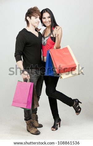 Attractive girl shopping with boyfriend - stock photo